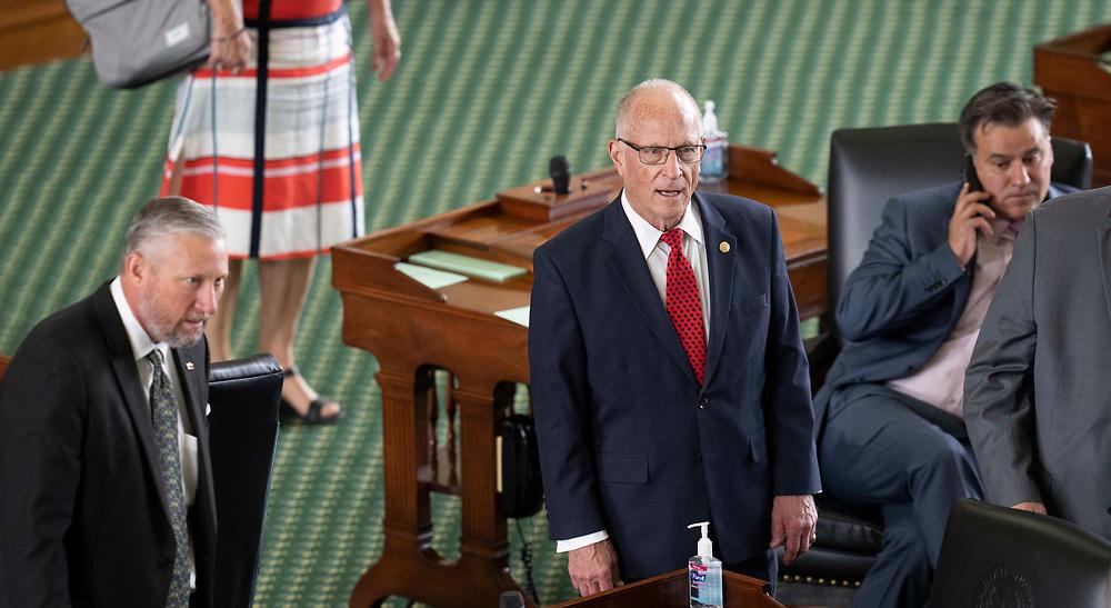 Se. Drew Springer, R-Muenster, Sen. Bob Hall, R-Edgewood and Sen. Roland Gutierrez, D-San Angelo, on the Senate floor on July 8, 2021.
