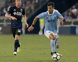 August 9, 2017 - Kansas City, Kansas, U.S - At foreground, Sporting KC midfielder Benny Feilhaber #10 gains the offensive field during the first half of the game. (Credit Image: © Serena S.Y. Hsu via ZUMA Wire)