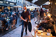 As Londoners await the announcement of a second coronavirus lockdown it's business as usual in the West End with people outside the bars and restaurants on Old Compton Street in Soho on what will be the last weekend before a month-long total lockdown in the UK on 31st October 2020 in London, United Kingdom. The three tier system in the UK has not worked sufficiently, to suppress the virus, and there have have been calls by politicians for a 'circuit breaker' complete lockdown to be announced to help the growing spread of the Covid-19.