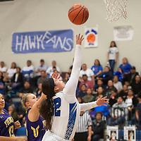 Laguna-Acoma Hawk Aaliyah Hershey (32) drives to the basket Friday night against the Tucumcari Rattlers at Laguna-Acoma Jr Sr High School in Casa Blanca.