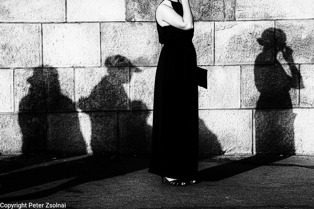 A women standing in tram station near the Chain Bridge
