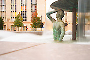 Ricardo Bofill architecture at Antigone. Strange statue of half a man, torso, standing in a spray of water. Montpellier. Languedoc. France. Europe.