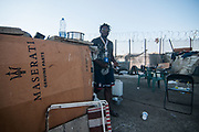 An illegal migrant walks in a camp near the railway station on August 03, 2017 in Crotone, Italy. The city of Crotone hosts one of the biggest european centre for migrants, but some of them live in clandestinity, even for two years, in an area near the city railway station, because they are afraid to be rejected and to be sent to their nations again. ©Simone Padovani