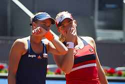 MADRID, May 14, 2017  Timea Babos (R) of Hungary and Andrea Hlavackova of the Czech Republic talk to each other during women's doubles final match of the Mutua Madrid Open against Martina Hingis of Switzerland and Chan Yung-Jan of Chinese Taipei in Madrid, Spain, May 13, 2017. Martina Hingis/Yung-Jan Chan won 2-0 and claimed the title. (Credit Image: © Eduardo Deguez And Belen Diaz/Xinhua News/Xinhua via ZUMA Wire)