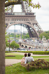 Couple enjoying the Eiffel Tower view, Paris, France. 08/05/14. Photo by Andrew Tallon