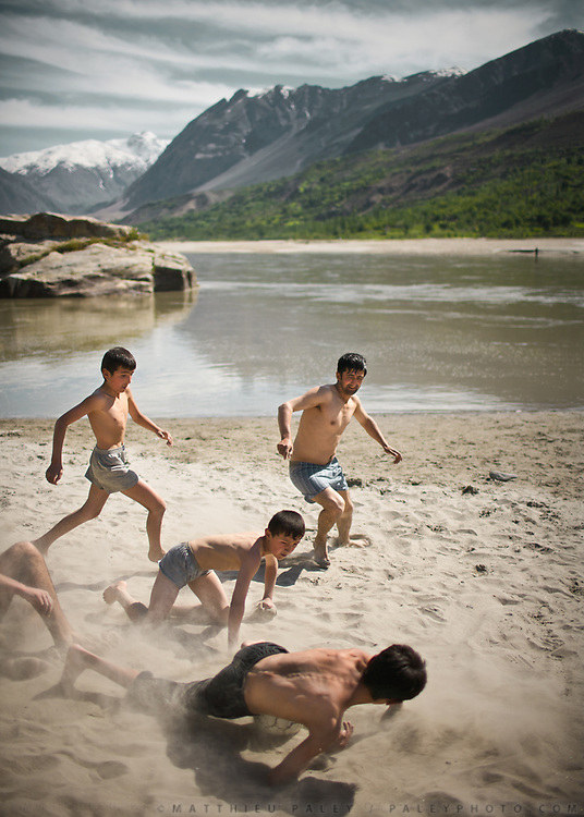 Playing football by the Amu Daria river - Afghanistan, an other world, on the other side. In Khorog town, capital of the Pamir and home of the Ismaili community.<br /> <br /> Tajikistan and the Tajik Pamir mountains (province of Gorno Badakhshan), summer 2009.