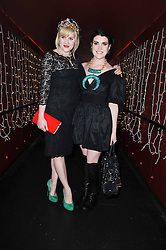 Left to right, sisters EMERALD FENNELL and COCO FENNELL  at a party and fashion show to celebrate the 40th anniversary of Butler & Wilson held at Koko, 1 Camden High Street, London NW1 on 12th November 2009.
