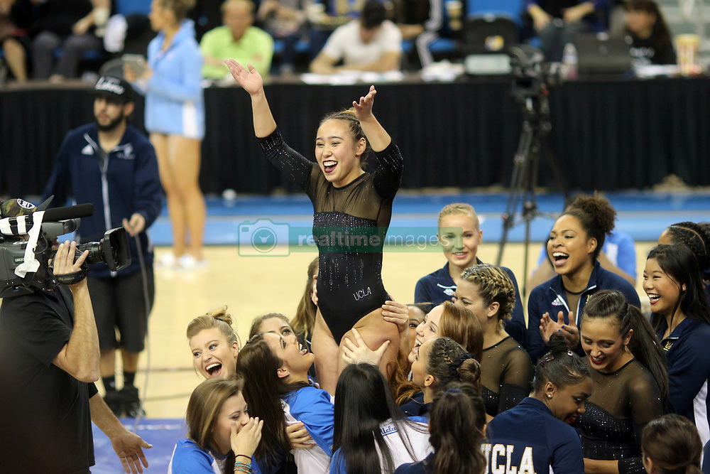 March 12, 2017 - Los Angeles, California, U.S - UCLA sophomore Katelyn Ohashi is congratulated by teammates after scoring a perfect 10 on the balance beam, helping to push the home team to victory in NCAA women's gymnastics versus North Carolina, March 12, 2017 (Los Angeles, California). The Plano, Texas native was previously a four-year member of the USA National Team. (Credit Image: © Jeremy Breningstall/ZUMA Wire)