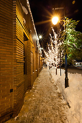 """""""Walkway in Downtown Truckee 1"""" - This icy and snowy walkway was photographed along the Bar of America brick building in Downtown Truckee, California."""