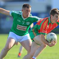 O'Curry's-Naomh Eoin's Odhran Lynch is tackled by Kilrush Shamrock's Matthew Moloney