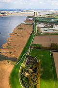 Nederland, Zeeland, Zeeuws-Vlaanderen, 09-05-2013; Hertogin Hedwigepolder met Westerschelde (links). Gezien naar de Prosperpolder, kerncentrale van Doel en haven Antwerpen in de achtergrond. In verband met de verdieping van de vaargeul van de nabijgelegen Westerschelde moet er volgens de Europese habitatrichtlijn natuurcompensatie komen. Door de polder en de Belgische Prosperpolder, aan de andere kant van de grens, te ontpolderen wordt er grond terug gegeven aan de natuur, zogenaamde natuurcompensatie. De maatregelen zijn omstreden, in het Belgisch deel van het gebied is men reeds begonnen..Hertogin Hedwigepolder with Drowned Land of Saeftinghe (left). Because of the future enlargement of the fairway of the nearby Westerschelde, the nature has to be compensated (according to the European Habitats Directive). The Hertogin Hedwige polder (and the adjacent Belgian polder - on the other side of the border - the Prosperpolder) are to be given back to nature, i.e. are to be 'de-polderd'. The measures are controversial, but in the Belgian part of the polders works have already been started..luchtfoto (toeslag op standard tarieven).aerial photo (additional fee required).copyright foto/photo Siebe Swart