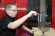 Child lights the Chanukah Menorah
