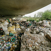 Recyclers (called Kabari) living under a bridge, below the Grand Trunk road (north of ITO bridge) and next to the Yamuna.