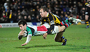 Wycombe, GREAT BRITAIN,  Harlequins', Danny CARE, touches down, Wasps, Mark van GISBERGEN tackling, during the the  London Wasps vs Harlequins at Adam's Park Stadium, Bucks on Sun 04.01.2009. [Photo, Peter Spurrier/Intersport-images]