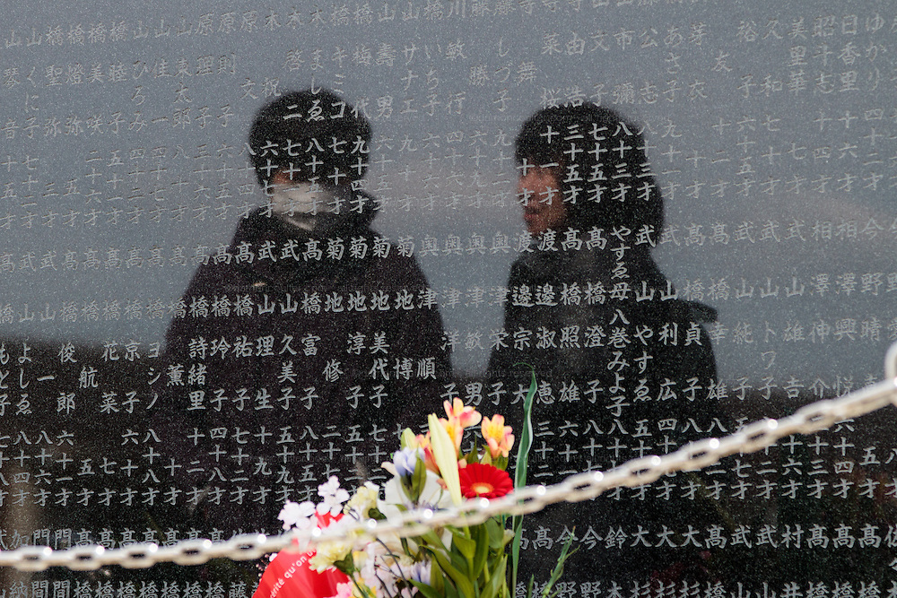 People visit a memorial to the victims of the tsunami at Okawa Elementary school in Ishinomaki, Miyagi, Japan. Thursday March 10th 2016. The Great East Japan Earthquake struck at 2:46pm on March 11th 2011 levelling much of the Tohoku coast and causing the deaths of around 18,000 people. including 84 students and staff at Okawa Elementary School