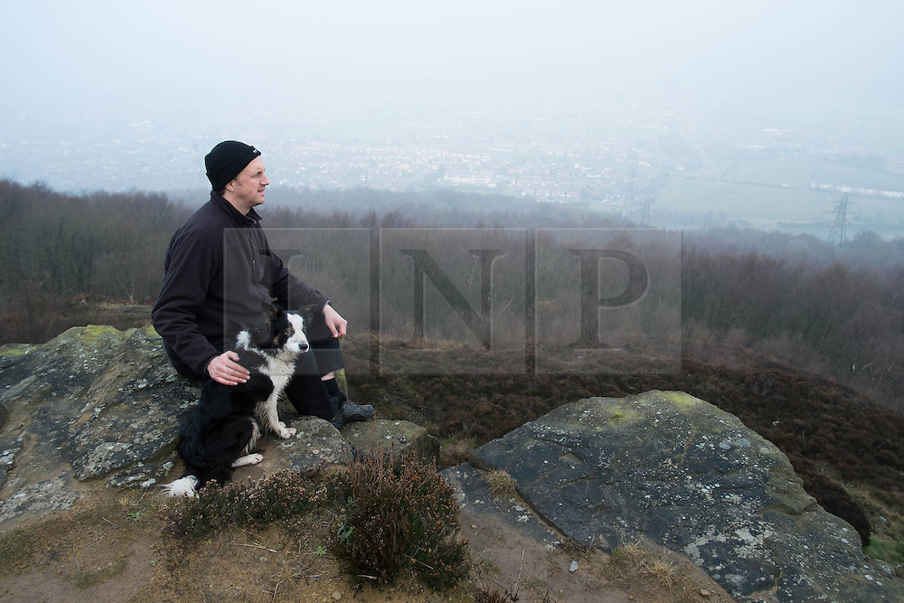 © Licensed to London News Pictures. 29/03/2014<br /> <br /> Eston Hills, Teesside, United Kingdom<br /> <br /> Craig Hornby from Saltburn looks out over Teesside from the top of Eston Nab. Craig is the chairman of the Friends of Eston Hills community group. The group gathered today to celebrate on the top of Eston Nab after raising £15000 in just seven weeks to buy the land. Eston Nab is the rocky summit of the Eston hills on the outskirts of Middlesbrough, Cleveland.<br /> <br /> The area will now be returned to public ownership for the first time in hundreds of years and there are plans to raise more funds to create a heritage trail, clean the site up and create a memorial to 375 miners who died when there was an iron mine on the site.<br /> <br /> <br /> Photo credit : Ian Forsyth/LNP
