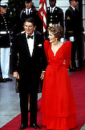 A 28.2 MG FILE FROM FILM OF:. President and Nancy Reagan wait on the steps of the North Portico of the White House for the arrival of the guest at a formal state Dinner. Photo by Dennis Brack
