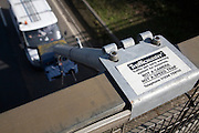 Trafficmaster traffic system camera monitoring vehicle flow from a bridge, UK