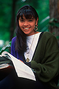 MEXICO, PORTRAITS, MEXICO CITY Female college student with books on campus of U.I.C. University