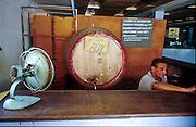 "25 JULY 2002 - HAVANA, HAVANA, CUBA: A rum stand in a market in Havana, Cuba, July 25, 2002. The sign on the barrel says ""we don't have rum."".PHOTO BY JACK KURTZ"