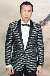 © Licensed to London News Pictures. 13/12/2016. DONNIE YEN attends the launch of Rogue One: A Star Wars Story. The film follows a group of unlikely heroes banding together on a mission to steal the plans to the Death Star, the Empire's ultimate weapon of destruction. This key event in the Star Wars timeline brings together ordinary people who choose to do extraordinary things, and in doing so, become part of something greater than themselves. London, UK. Photo credit: Ray Tang/LNP