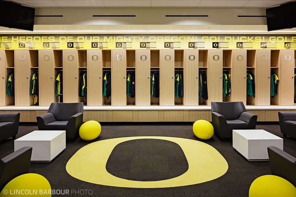 Architectural photo of University of Oregon's Women's Soccer & Lacrosse Stadium. Designed by DLR Group. A graphic view of the lockers with the 'O' on the floor filling the foreground