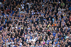 Fans show their support as Fulham and Sheffield Wednesday players observe a minute's applause for the Barcelona attack.