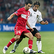 Turkey's Arda TURAN (L) and Germany's Sami KHEDIRA (R) during their UEFA EURO 2012 Qualifying round Group A matchday 19 soccer match Turkey betwen Germany at TT Arena in Istanbul October 7, 2011. Photo by TURKPIX