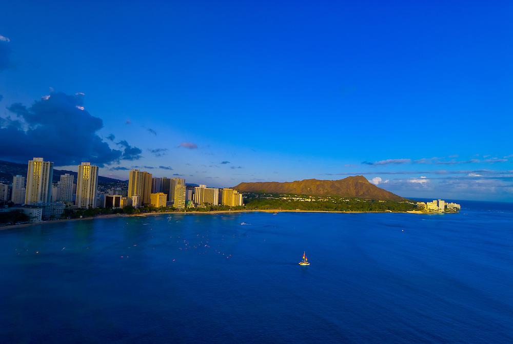 Aerial view of a catamaran cruising from Waikiki Beach with Diamond Head in back, Honolulu, Oahu, Hawaii, USA