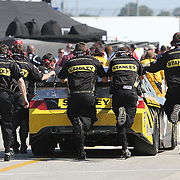 Sprint Cup Series driver Marcos Ambrose (9) gets a push down pit road at Daytona International Speedway on February 18, 2011 in Daytona Beach, Florida. (AP Photo/Alex Menendez)
