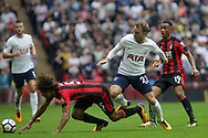 Nathan Ake of AFC Bournemouth falls under Christian Eriksen of Tottenham Hotspur.<br /> Premier league match, Tottenham Hotspur v AFC Bournemouth at Wembley Stadium in London on Saturday 14th October 2017.<br /> pic by Kieran Clarke, Andrew Orchard sports photography.