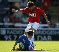 Photo: Paul Thomas.<br />Peterborough United v Manchester United. Pre Season Friendly. 04/08/2007.<br /><br />New Utd signing Owen Hargreaves battles against Craig Morgan (Ground).