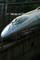"""The """"Nozomi"""" is the newest version of the Shinkansen, popularly known overseas as the """"bullet train"""".  The Nozomi can reach speeds of up to 320 km/h (200 mph) although they currently operate at a maximum of 300 km/h (186 mph) in service. Nozomi trains stop only at the most important stations, and reach Osaka from Tokyo in about two and a half hours."""