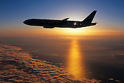 Boeing 777 in flight at sunset