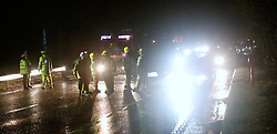 ramshott,Surrey  Saturday 26th March 2016 A Family  have  escaped to tell the tale after  their  car ploughed  into high voltage Power Cables on a major truck road this evening.<br /> The incident unfolded on the Northbound section of the A3 earlier this evening(Saturday)   The cable  that was carrying 11,000 Volt was blown down by storm force winds into the live traffic lanes of the busy A3  near Bramshott Chase in Surrey.  The vehicle that contained a family hit the cable and a second vehicle  traveling close behind  than rear ended  vehicle causing their car to flip on to its roof  and roll down in  gully.  The driver escaped without serious injury. A young child hat was in the same vehicle  was taken to hospital with a suspect broken arm and  other injuries.   The incident closed both carriageways of the A3  whilst Emergency services from Surrey and Hampshire fire and rescue service  made the  area safe.  Four car lengths  behind was a fully laden petrol tanker.  The closure created massive 3 mile  traffic  jams in and around the area whilst  many tried to seek alternative routes.<br /> Specialists from Scottish and Southern were  called in to make the power cables safe. Many home in the area have been left without power.©UKNIP