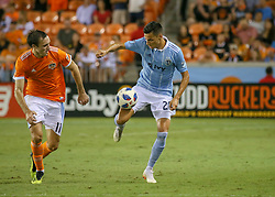 August 4, 2018 - Houston, TX, U.S. - HOUSTON, TX - AUGUST 04:  Sporting Kansas City forward Daniel Salloi (20) maintains control of the ball and away from Houston Dynamo forward Andrew Wenger (11) during the soccer match between Sporting Kansas City and Houston Dynamo on August 4, 2018 at BBVA Compass Stadium in Houston, Texas.  (Photo by Leslie Plaza Johnson/Icon Sportswire) (Credit Image: © Leslie Plaza Johnson/Icon SMI via ZUMA Press)