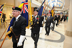 © Licensed to London News Pictures. 26/10/2014<br />   Bluewater Poppy appeal Parade Launch today  (26.10.2014) in Kent<br /> Bluewater joins forces with the Royal British Legion to remember In the year that marks 100 years since the birth of the poppy as a symbol of Remembrance and hope, Bluewater is supporting the Royal British Legion's Poppy Appeal campaign with a two-week mall takeover, beginning with the formal launch of the Poppy Appeal in Kent. The 26th October has seen an external parade of 150 people, including standard bearers, veterans, serving personnel, reserves, cadets, Scouts and Brownies joining the Royal British Legion in a procession around Bluewater. Also attending the parade will be Gareth Johnson, MP for Dartford, Councillor Avtar Sandhu MBE, the Mayor of Dartford, and Councillor John Caller, the Mayor of Gravesham. Concluding the launch of the Poppy Appeal at 12:20pm will be a performance by Gareth Malone's Military Wives Choir, from Brompton Barracks in Chatham. The Military Wives will sing in Bluewater's Plaza (outside Glow) before the Royal British Legion leads a spoken tribute and minute's silence. From then until 11th November, when there will be a Remembrance Day memorial silence, the Royal British legion will be stationed at an in-mall collection point on the lower Thames Walk fundraising for the charity.<br /> <br /> (Byline:Grant Falvey/LNP)
