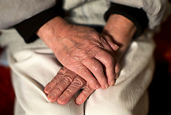 File photo dated 17/03/16 of the hands of a woman, as a watchdog warned that the quality and safety of care services for elderly and disabled people in England risks being undermined by financial pressures.