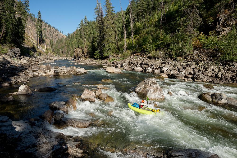 Paddling an inflatable kayak on Idaho's Selway River.