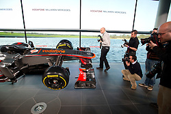© London News Pictures. 31/01/2013 . Woking, UK.  Photographers photograph the front of the new McLaren Mercedes MP4-28 Formula 1 car at its unveiling at the McLaren Technology Centre in Woking, Surrey, UK on Thursday, Jan. 31, 2013. Photo credit : Ben Cawthra/LNP