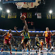 Fenerbahce's Angel MCoughtry (C) and Galatasaray's Sancho Lyttle (L) during their Turkish Basketball woman league derby match Fenerbahce between Galatasaray at Ulker Sports Arena in Istanbul, Turkey, wednesday, December 26, 2012. Photo by Aykut AKICI/TURKPIX