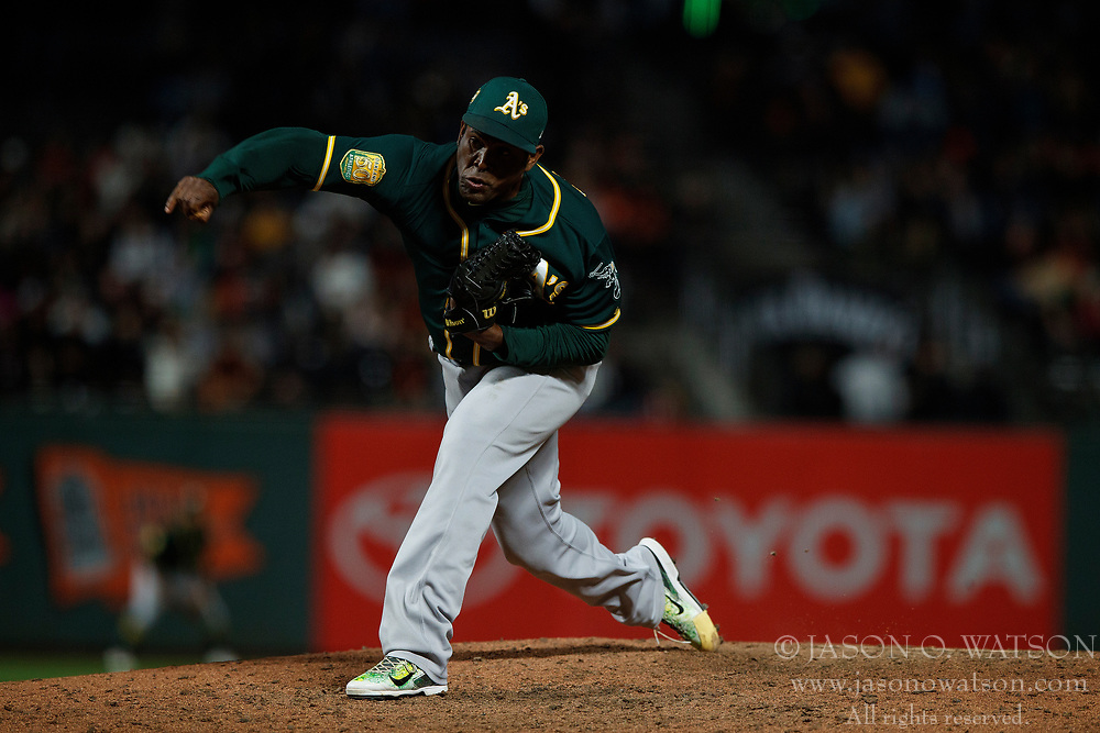 SAN FRANCISCO, CA - JULY 13: Santiago Casilla #46 of the Oakland Athletics pitches against the San Francisco Giants during the eighth inning at AT&T Park on July 13, 2018 in San Francisco, California. The San Francisco Giants defeated the Oakland Athletics 7-1. (Photo by Jason O. Watson/Getty Images) *** Local Caption *** Santiago Casilla