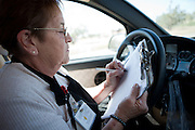 Bernis Chavez records notes on her meals delivered to Torrance County senior citizens. New Mexico has received more than $601,000 for senior meals programs around the state.