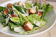 Lettuce Salad with croutons and salad dressing. Most dieting woman wrongly think that such a meal is good for them
