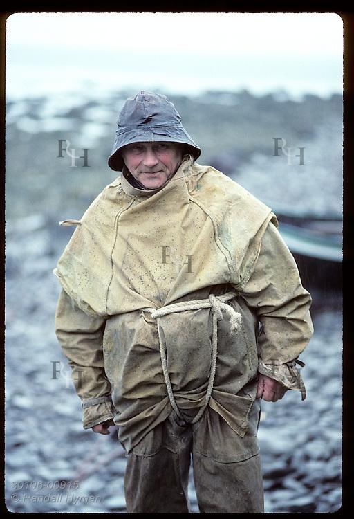 Curator Geir Gudmundsson wears fisherman's garb outside Osver maritime museum; (v) Bolungarvik Iceland