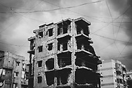 War-damaged apartment building in the Sabra and Shatila refugee camps in south Beirut, Lebanon. The camp was established for Palestinians in 1949.