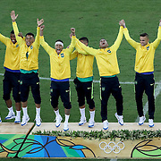 Football - Olympics: Day 15  Neymar #10 of Brazil wearing a head band and his teammates celebrate their gold medal win on the podium during the Brazil Vs Germany Men's Football Gold Medal Match at Maracana on August 20, 2016 in Rio de Janeiro, Brazil. (Photo by Tim Clayton/Corbis via Getty Images)
