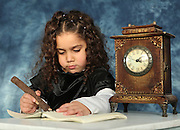 Atmospheric image of a sad lonely Girl of five doing homework next to an old style mantel place clock