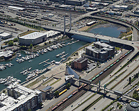 Oblique view of the south end of the Thea Foss Waterway, visible in this photo are the Museum of Glass, Albers Mill Lofts Apartments, The Henry, Dock Street Marina, and the East 21st Street Bridge.