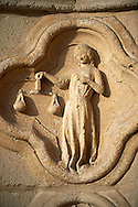 Gothic sculpture depicting The Libre sign of the zodiac on the west entrance of the Cathedral of Notre-Dame, Amiens, France . The Cathedral Basilica of Our Lady of Amiens or simply Amiens Cathedral, is a Roman Catholic  cathedral the seat of the Bishop of Amiens. It is situated on a slight ridge overlooking the River Somme in Amiens. Amiens Cathedral, was built almost entirely between 1220 and c.1270, a remarkably short period of time for a Gothic cathedral, giving it an unusual unity of style. Amiens is a classic example of the High Gothic style of Gothic architecture. It also has some features of the later Rayonnant style in the enlarged high windows of the choir, added in the mid-1250s. Amiens Cathedra has been listed as a UNESCO World Heritage Site since 1981. Photos can be downloaded as Royalty Free photos or bought as photo art prints. <br /> <br /> Visit our MEDIEVAL PHOTO COLLECTIONS for more   photos  to download or buy as prints https://funkystock.photoshelter.com/gallery-collection/Medieval-Middle-Ages-Historic-Places-Arcaeological-Sites-Pictures-Images-of/C0000B5ZA54_WD0s